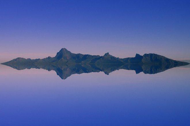 Rising sun over Moorea. Photo Pierre Lesage